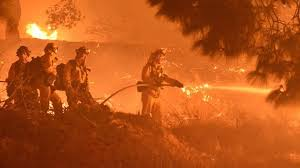 Firefighters battling California fires;