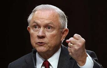 Jeff Sessions holding up a balled up fist;