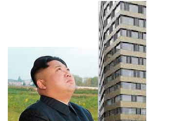 Kim Jong-un looking up at a high rise buildring;