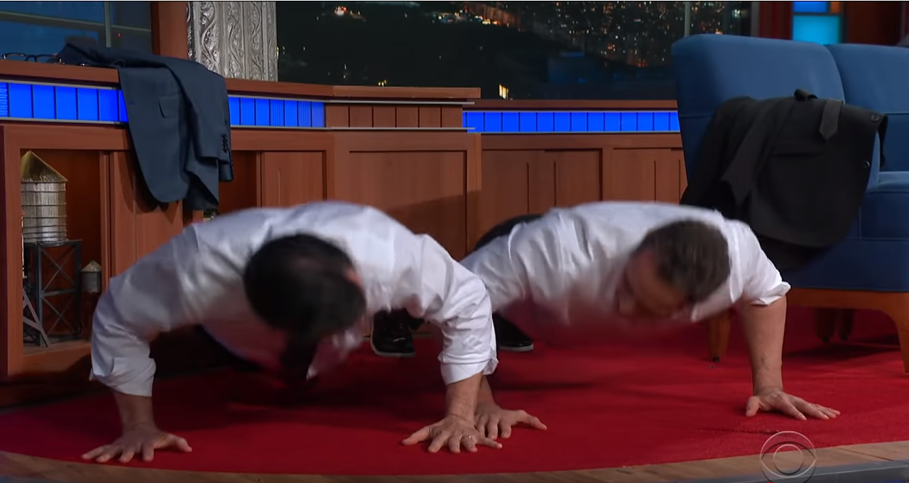 Stephen Colbert Chris Cuomo doing push-ups;