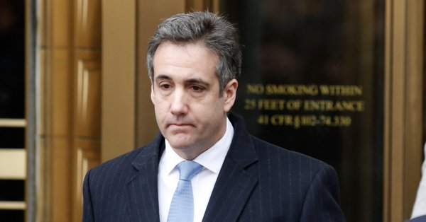 Michael Cohen looking sad walking out of a federal courtroom;
