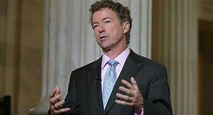 Senator Rand Paul speaking to the press outside the chamber;