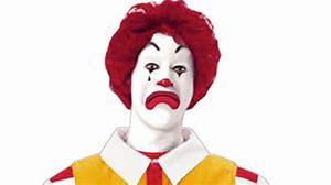 Ronald McDonald looking sad;